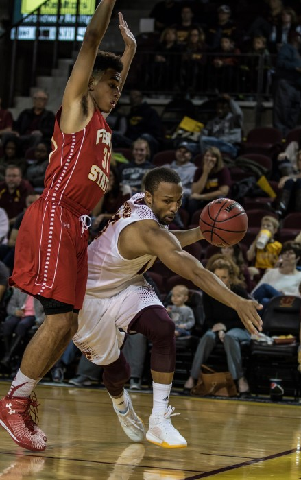 CHris Fowler, 15, goes baseline against during the game against Drew Cushingberry, 31, Ferris State University in McGuirk Arena on the campus of Central Michigan University, Mt. Pleasant, Michigan, Saturday, November 7, 2015.