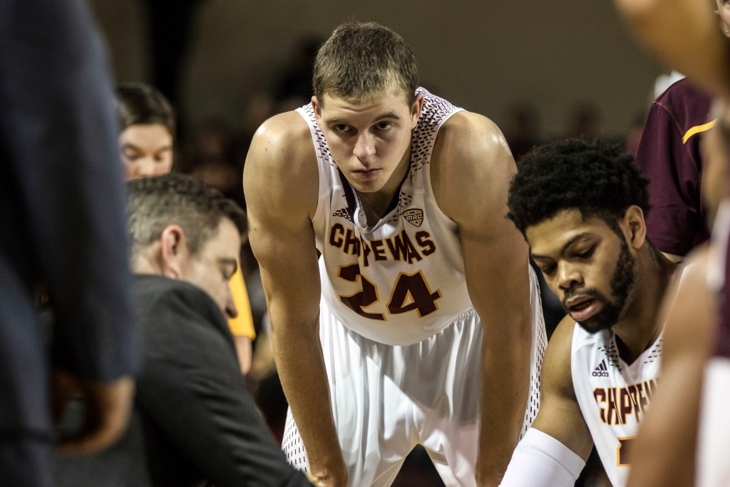 Luke Meyer, 24, listens to Keno Davis in a timeout. during the game against Ferris State University in McGuirk Arena on the campus of Central Michigan University, Mt. Pleasant, Michigan, Saturday, November 7, 2015.