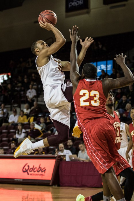 Chris Fowler, 15, throws up a layup against Matt Sinnaeve, 23, during the game against Ferris State University in McGuirk Arena on the campus of Central Michigan University, Mt. Pleasant, Michigan, Saturday, November 7, 2015.