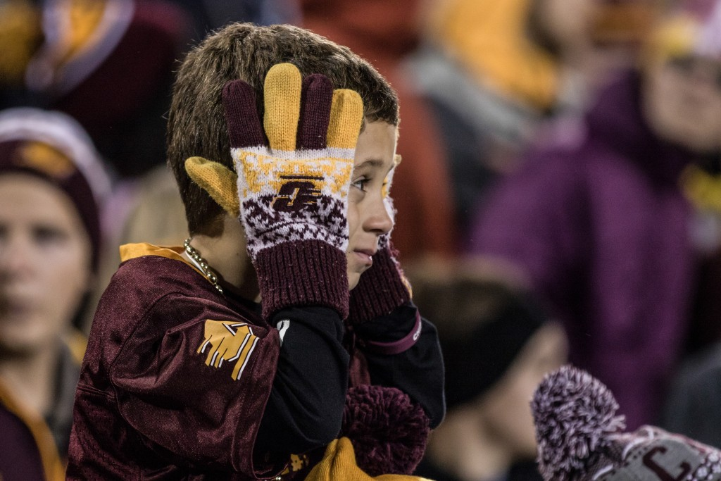 A young fan reacts to an opposing touchdown during the game against University of Toledo at Kelly Shorts Stadium, on the campus of Central Michigan University, Mt. Pleasant, Michigan, Tuesday, November 10, 2015.