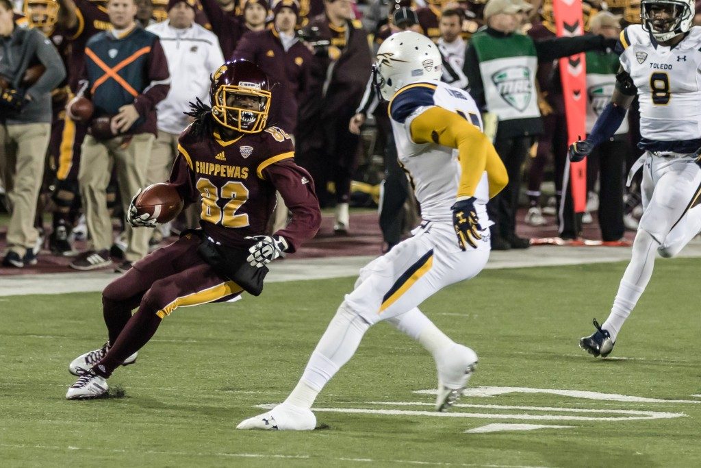 Corey Willis, 82, looks to juke a Toledo defender during the game against the University of Toledo at Kelly Shorts Stadium, on the campus of Central Michigan University, Mt. Pleasant, Michigan, Tuesday, November 10, 2015.