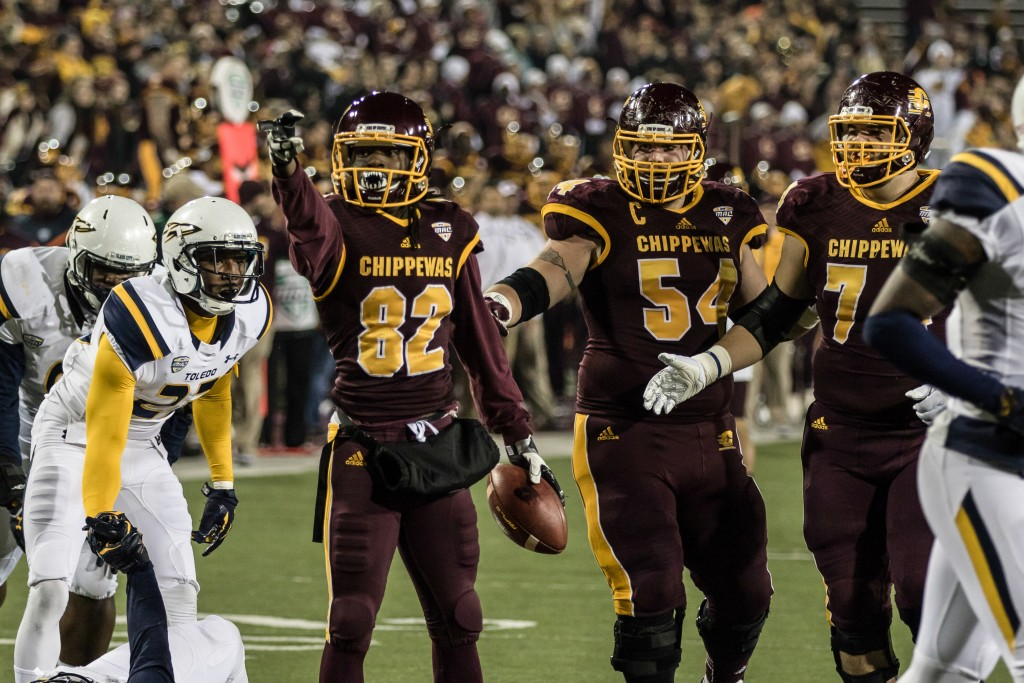 Corey Willis, 82, celebrates a big play the game against the University of Toledo at Kelly Shorts Stadium, on the campus of Central Michigan University, Mt. Pleasant, Michigan, Tuesday, November 10, 2015.