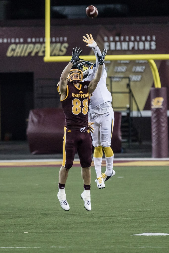 Jesse Kroll, 88, and Cheatham Norris, 1, fight for a jump ball during the game against the University of Toledo at Kelly Shorts Stadium, on the campus of Central Michigan University, Mt. Pleasant, Michigan, Tuesday, November 10, 2015.
