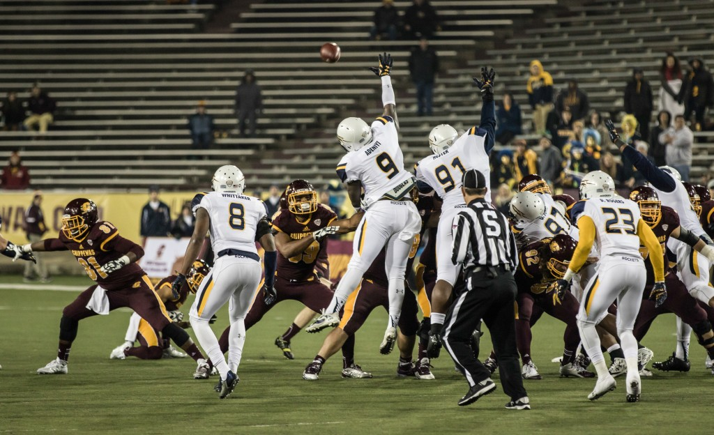 Toledo defenders try to block a field goal during the game against Central Michigan University at Kelly Shorts Stadium, on the campus of Central Michigan University, Mt. Pleasant, Michigan, Tuesday, November 10, 2015.