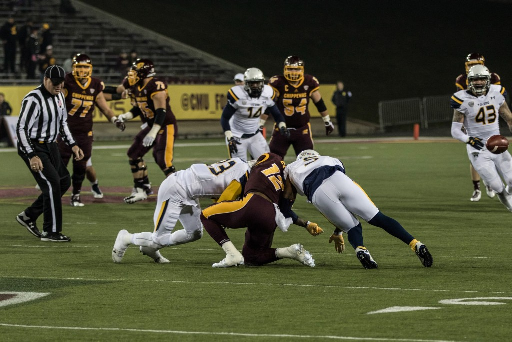 Eric Cooper, 12, is crushed in between DeJuan Rodgers, 23, and Christian Dukes during the game against the University of Toledo at Kelly Shorts Stadium, on the campus of Central Michigan University, Mt. Pleasant, Michigan, Tuesday, November 10, 2015.