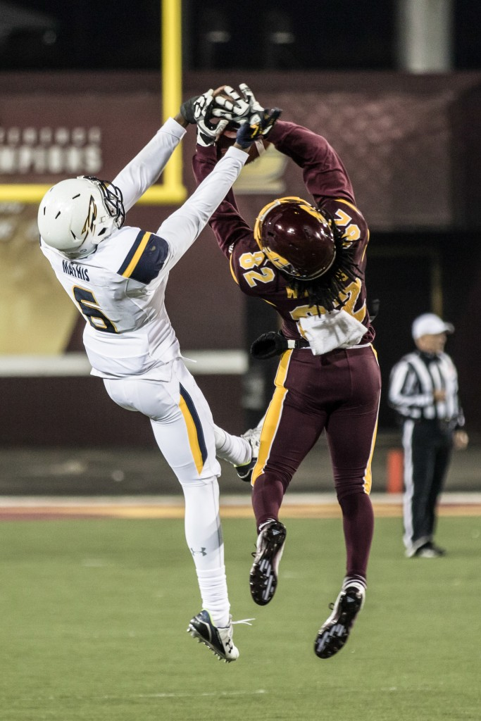Corey WIllies, 82, and Trevon Mathis, 6, battle for a ball during the game against the University of Toledo at Kelly Shorts Stadium, on the campus of Central Michigan University, Mt. Pleasant, Michigan, Tuesday, November 10, 2015.