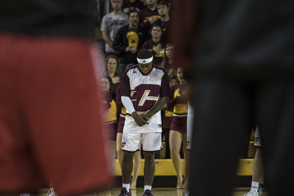 Braylon Rayson bows his head during the National Anthem before the game against Jacksonville State University in McGuirk Arena, on the campus of Central Michigan University, Mt. Pleasant, Michigan, Friday, November 13, 2015.