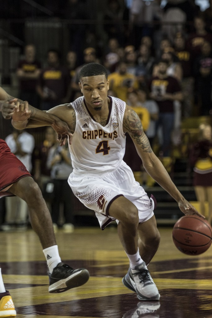 Rayshawn Simmons, 4, drives the ball during the game against Jacksonville State University in McGuirk Arena, on the campus of Central Michigan University, Mt. Pleasant, Michigan, Friday, November 13, 2015.