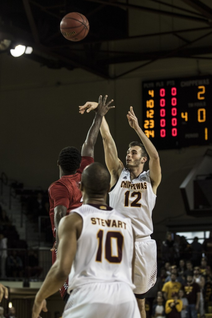 Josh Kozinski, 12, takes a jumper as Austin Stewart, 10 looks on during the game against Jacksonville State University in McGuirk Arena, on the campus of Central Michigan University, Mt. Pleasant, Michigan, Friday, November 13, 2015.