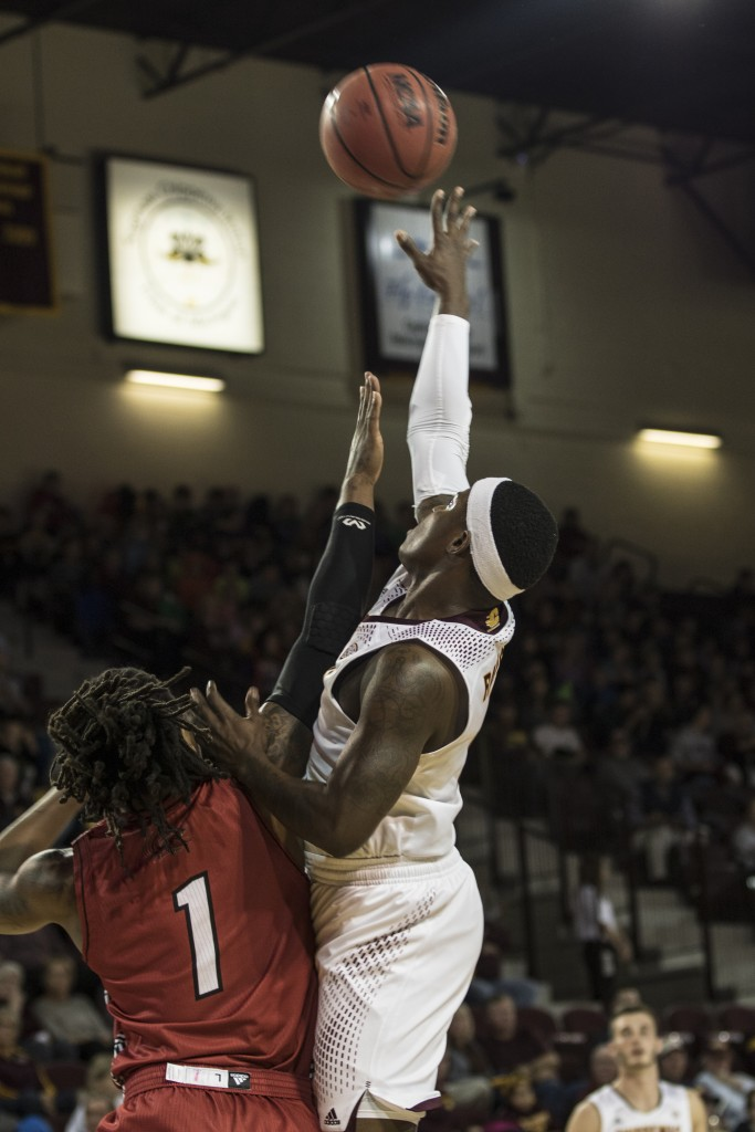 Braylon Rayson, right, throws up a floater agaisnt Greg Tucker, 1, during the game against Jacksonville State University in McGuirk Arena, on the campus of Central Michigan University, Mt. Pleasant, Michigan, Friday, November 13, 2015.