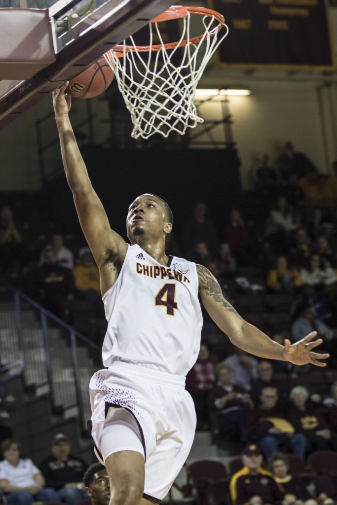 Rayshawn Simmons, 4, goes for the lay up during the game against Jacksonville State University in McGuirk Arena, on the campus of Central Michigan University, Mt. Pleasant, Michigan, Friday, November 13, 2015.