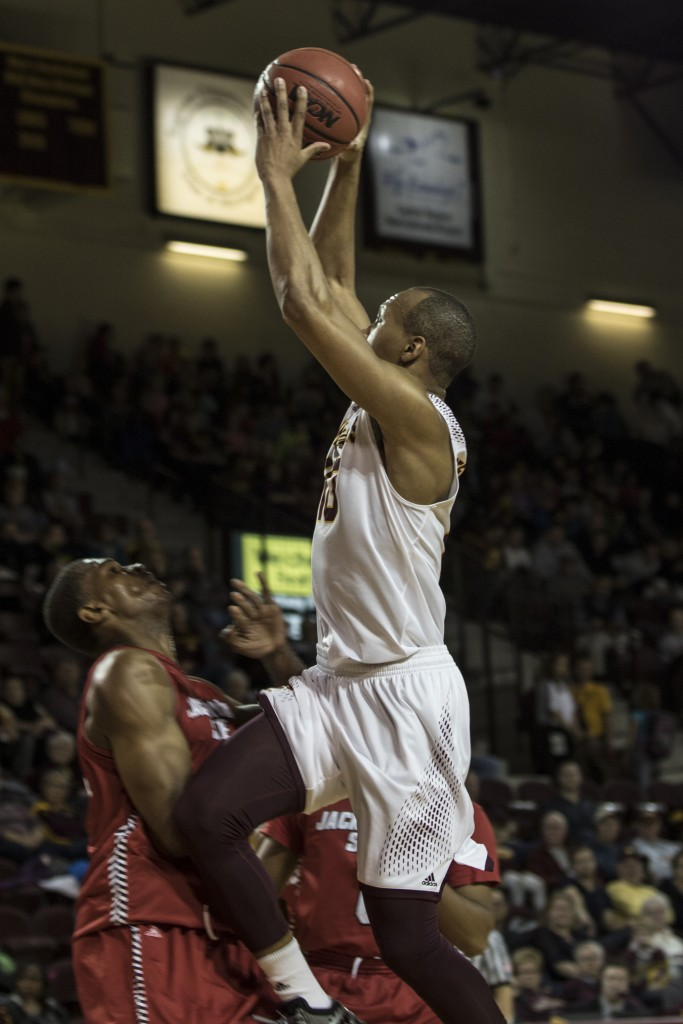 Austin Stewart, 10, attempts to dunk the ball during the game against Jacksonville State University in McGuirk Arena, on the campus of Central Michigan University, Mt. Pleasant, Michigan, Friday, November 13, 2015.