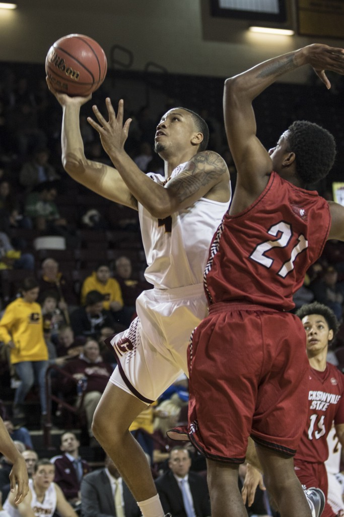 Rayshawn Simmons, 4, attempts a lay up against Malcolm Drumwright, 21, during the game against Jacksonville State University in McGuirk Arena, on the campus of Central Michigan University, Mt. Pleasant, Michigan, Friday, November 13, 2015.