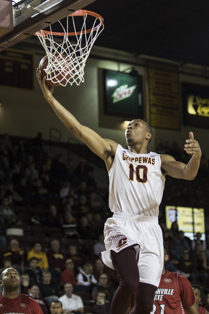 Austin Stewart, 10, lays the ball in during the game against Jacksonville State University in McGuirk Arena, on the campus of Central Michigan University, Mt. Pleasant, Michigan, Friday, November 13, 2015.