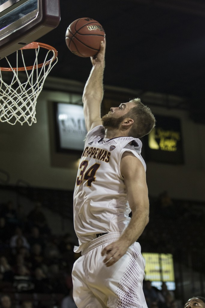 John Simons, 34, attempts the dunk during the game against Jacksonville State University in McGuirk Arena, on the campus of Central Michigan University, Mt. Pleasant, Michigan, Friday, November 13, 2015.