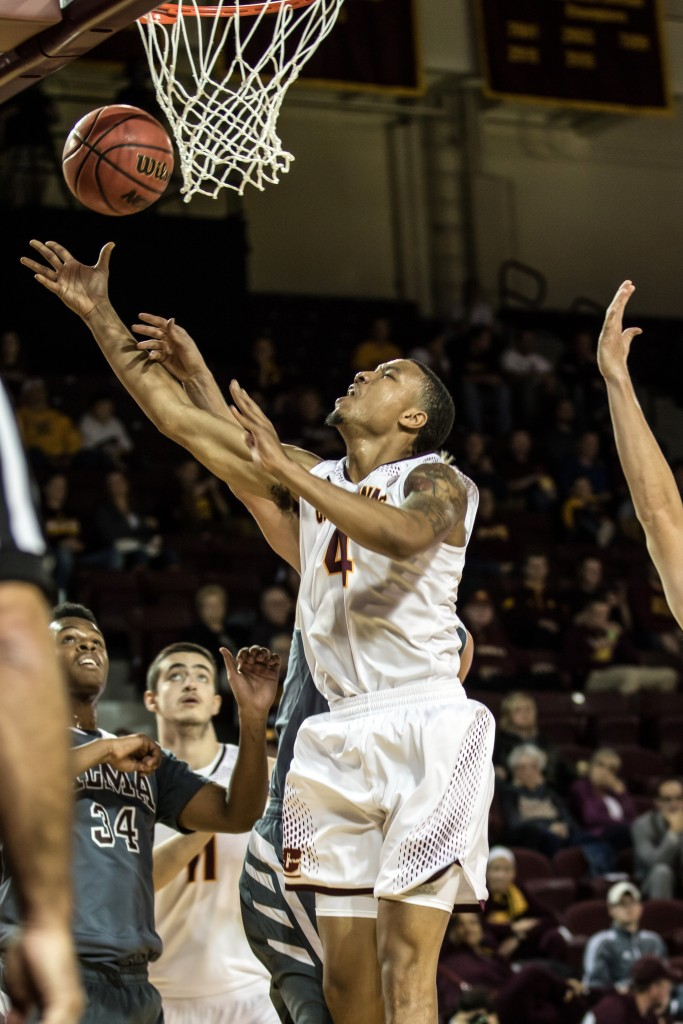Rayshawn Simmons, 4, is fouled on his way to the hoop by an Alama defender during the game against Alma College at McGuirk Arena in Mt. Pleasant, Michigan, Tuesday, November 17, 2015.