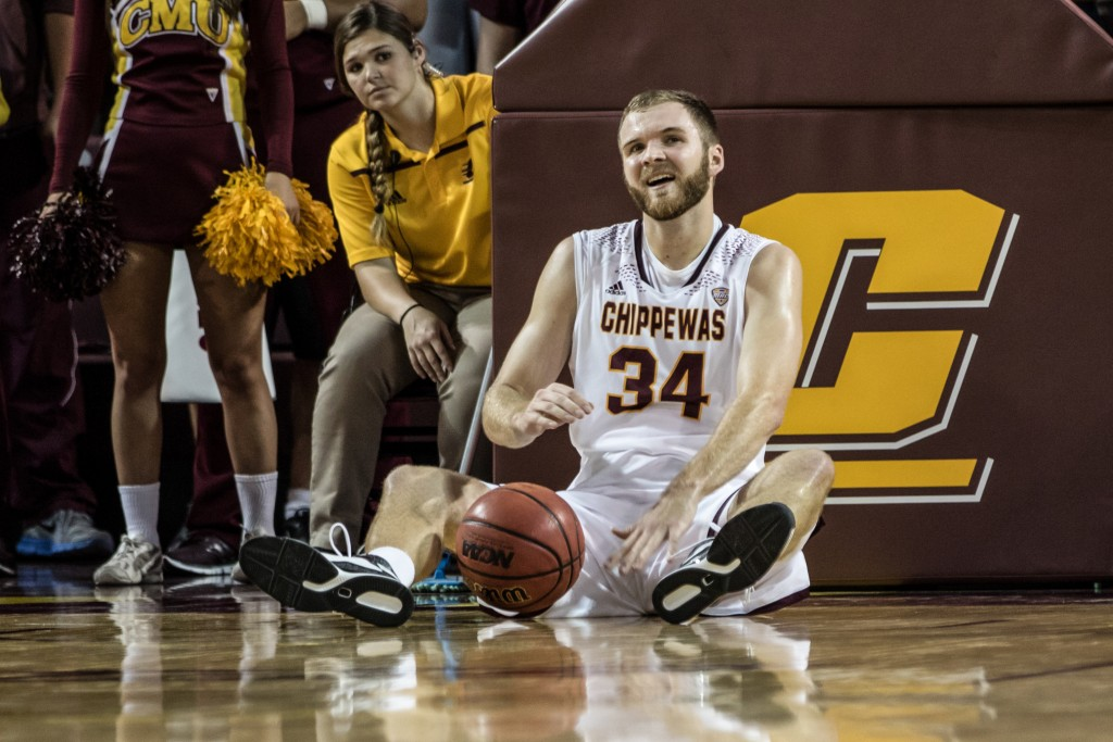 John Simons, 34, laughs at a call from the ref during the game against Alma College at McGuirk Arena in Mt. Pleasant, Michigan, Tuesday, November 17, 2015.
