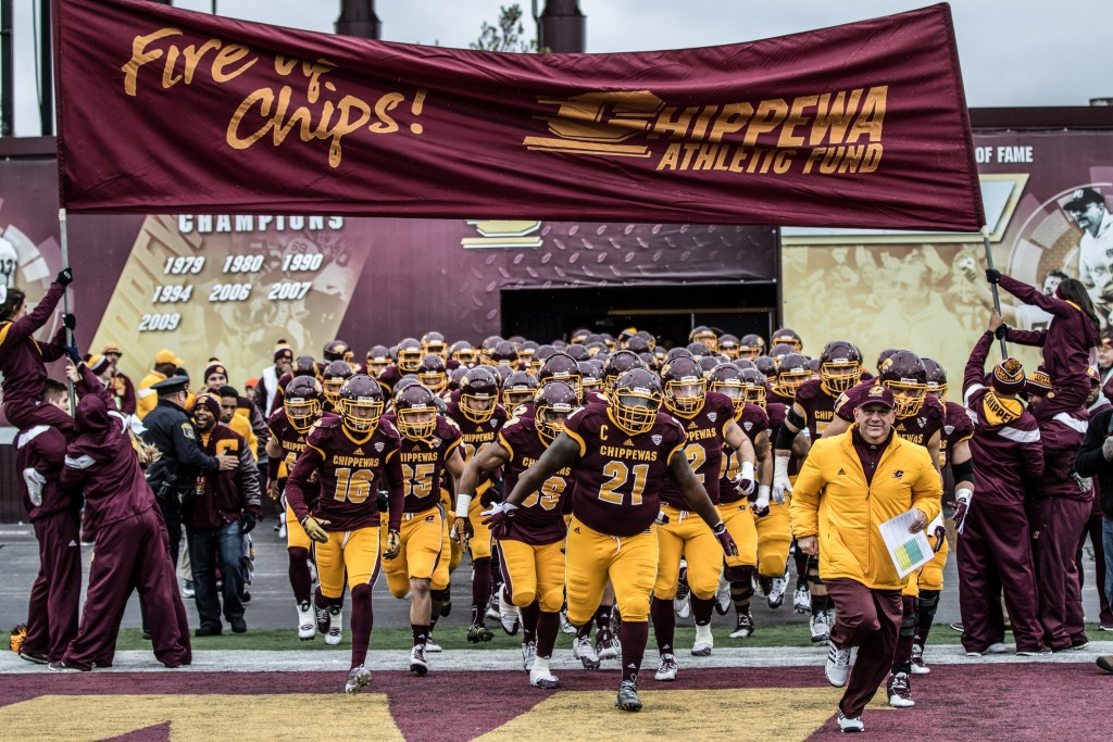 The Chippewas take the field before the game against Eastern Michigan University at Kelly / Shorts Stadium on the campus of Central Michigan University, Mt. Pleasant, Michigan, Friday, November 27, 2015.