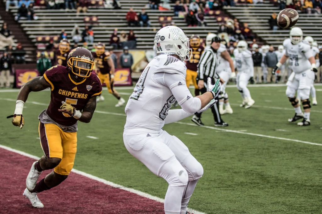 Sam Browning, right, hauls in a touchdown while Kavon Frazier, 5, watches on during the game against Eastern Michigan University at Kelly / Shorts Stadium on the campus of Central Michigan University, Mt. Pleasant, Michigan, Friday, November 27, 2015.
