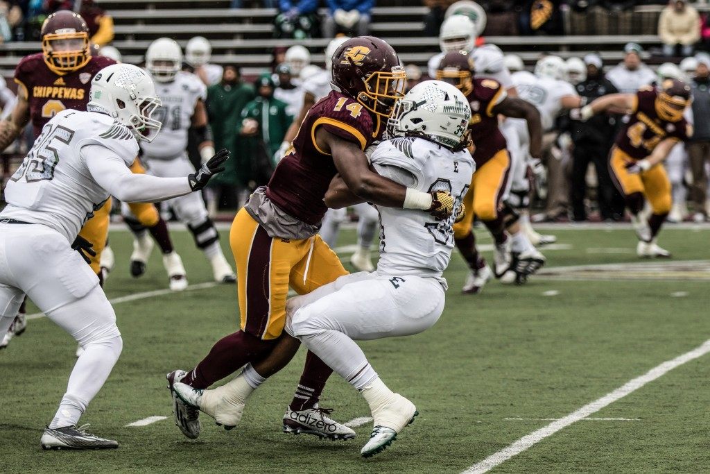 Josh Cox, 14, lays a big hit on the ball carrier during the game against Eastern Michigan University at Kelly / Shorts Stadium on the campus of Central Michigan University, Mt. Pleasant, Michigan, Friday, November 27, 2015.