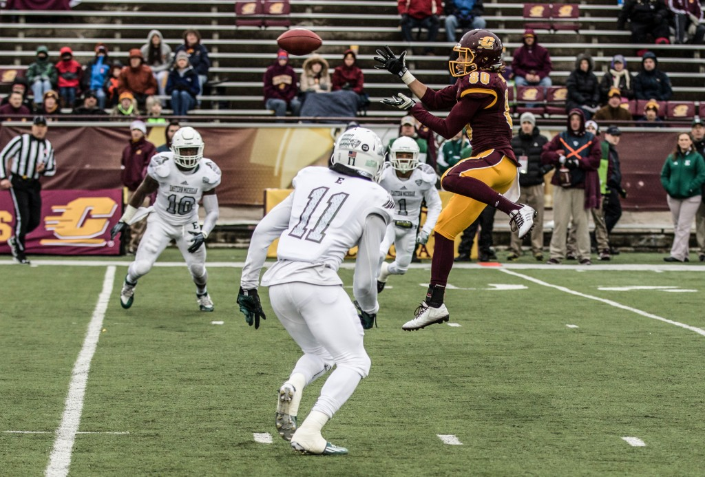 Anthony Rice, 80, catches a ball amongst three defenders during the game against Eastern Michigan University at Kelly / Shorts Stadium on the campus of Central Michigan University, Mt. Pleasant, Michigan, Friday, November 27, 2015.