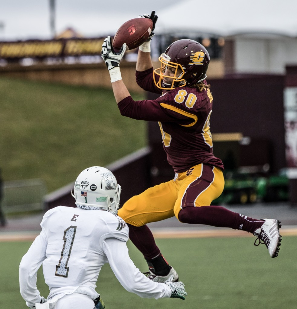 Anthony Rice, 80, makes a spinning catches while being defended by DaQuan Pace, 1, during the game against Eastern Michigan University at Kelly / Shorts Stadium on the campus of Central Michigan University, Mt. Pleasant, Michigan, Friday, November 27, 2015.