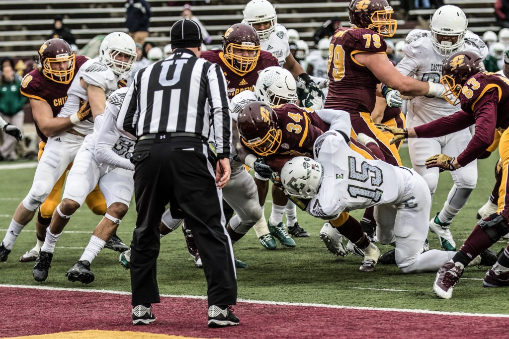 Romello Ross, 34, fights his way into the end zone during the game against Eastern Michigan University at Kelly / Shorts Stadium on the campus of Central Michigan University, Mt. Pleasant, Michigan, Friday, November 27, 2015.