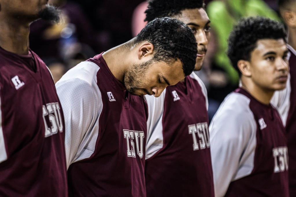 Jose Rodriguez bows his head during the National Anthem before the game against at McGuirk Arena on the campus of Central Michigan University, Mt. Pleasant, Michigan, Saturday, December 12, 2015. | Rich Drummond