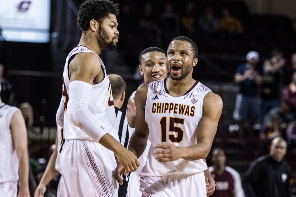 Chris Fowler, 15, celebrates with DaRohn Scott, left, and Rayshawn Simmons, back, during the game against Texas Southern University at McGuirk Arena on the campus of Central Michigan University, Mt. Pleasant, Michigan, Saturday, December 12, 2015. | Rich Drummond