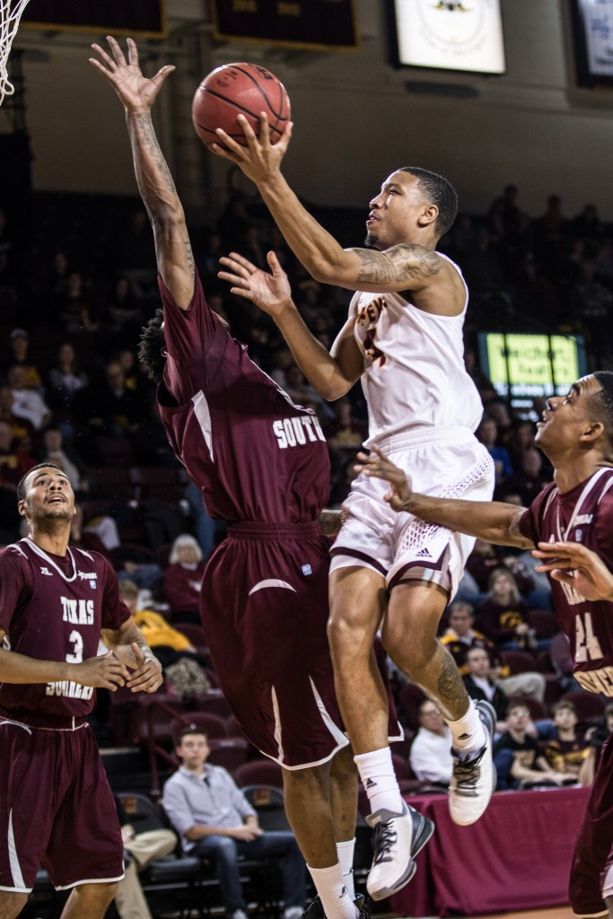 Rayshawn Simmons, 4, goes up for the lay up against a group of defenders during the game against Texas Southern University at McGuirk Arena on the campus of Central Michigan University, Mt. Pleasant, Michigan, Saturday, December 12, 2015. | Rich Drummond