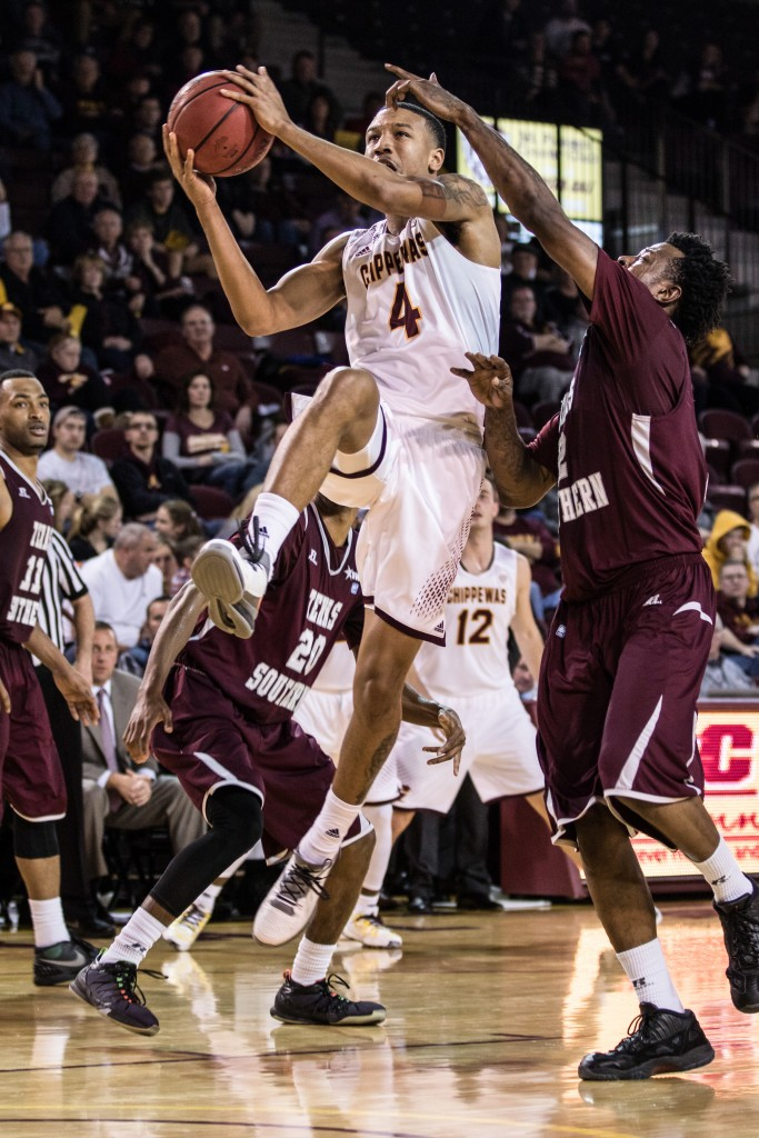 Rayshawn SImmons, 4, tries the lay up against, Chris Thomas, 2, during the game against Texas Southern University at McGuirk Arena on the campus of Central Michigan University, Mt. Pleasant, Michigan, Saturday, December 12, 2015. | Rich Drummond