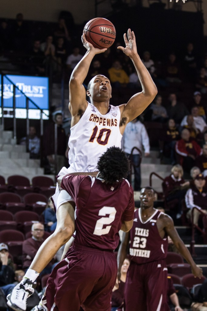 Austin Stewart, 10, goes up for the lay up against Chris Thomas, 2, during the game against Texas Southern University at McGuirk Arena on the campus of Central Michigan University, Mt. Pleasant, Michigan, Saturday, December 12, 2015. | Rich Drummond