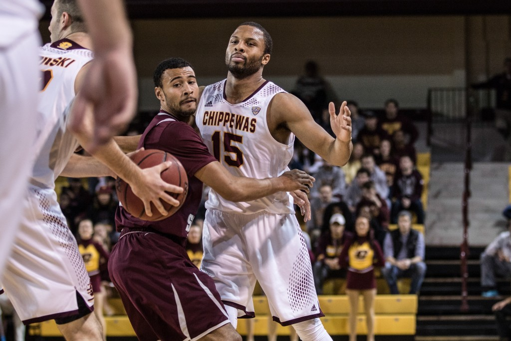 Chris Fowler, 15, is hugged by David Banks, left, during the game against Texas Southern University at McGuirk Arena on the campus of Central Michigan University, Mt. Pleasant, Michigan, Saturday, December 12, 2015. | Rich Drummond