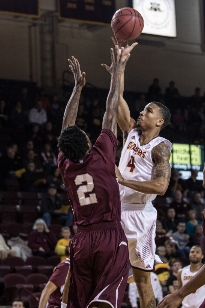 Rayshawn Simmons, 4, throws up the floater against Chris Thomas, 2, during the game against Texas Southern University at McGuirk Arena on the campus of Central Michigan University, Mt. Pleasant, Michigan, Saturday, December 12, 2015. | Rich Drummond