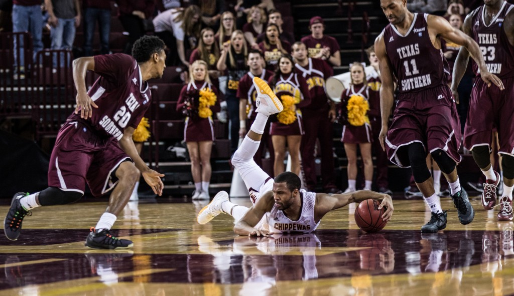 Chris Fowler, middle, takes a fall during the game against Texas Southern University at McGuirk Arena on the campus of Central Michigan University, Mt. Pleasant, Michigan, Saturday, December 12, 2015. | Rich Drummond