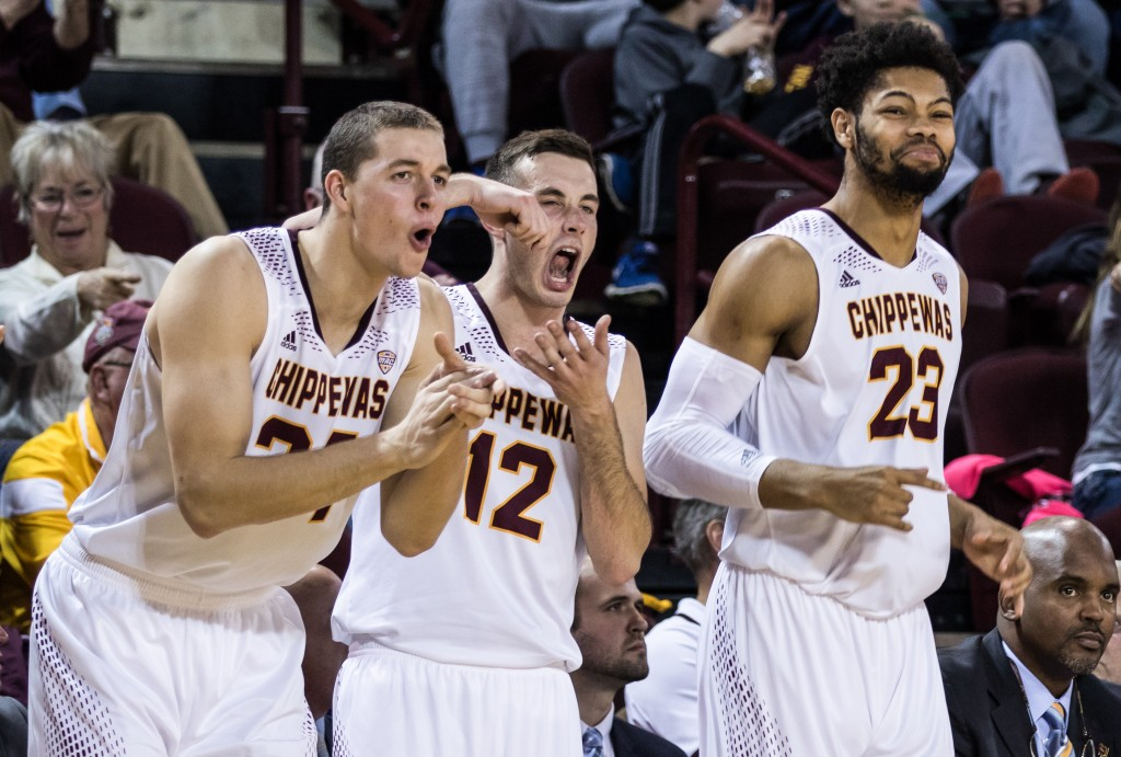 Luke Meyer, left, Josh Kozinski, middle, and DaRohn Scott, right, celebrate a big play during the game against Texas Southern University at McGuirk Arena on the campus of Central Michigan University, Mt. Pleasant, Michigan, Saturday, December 12, 2015. | Rich Drummond