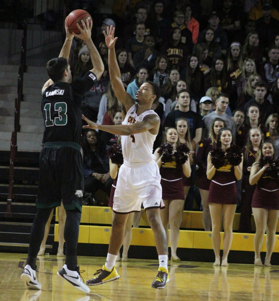 Guard Rayshawn Simmons (4) defends the three point line in the first half of Central Michigan's 72-49 victory against Ohio University.
