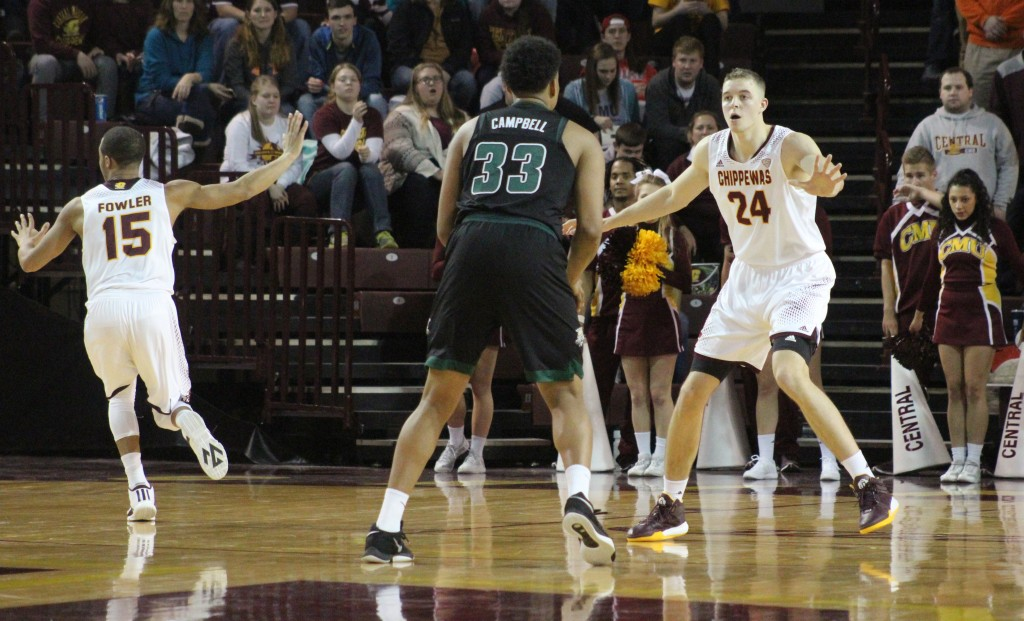 Forward Luke Meyer (24) defends his man at the three point line in the second half of Central Michigan's victory against Ohio University.
