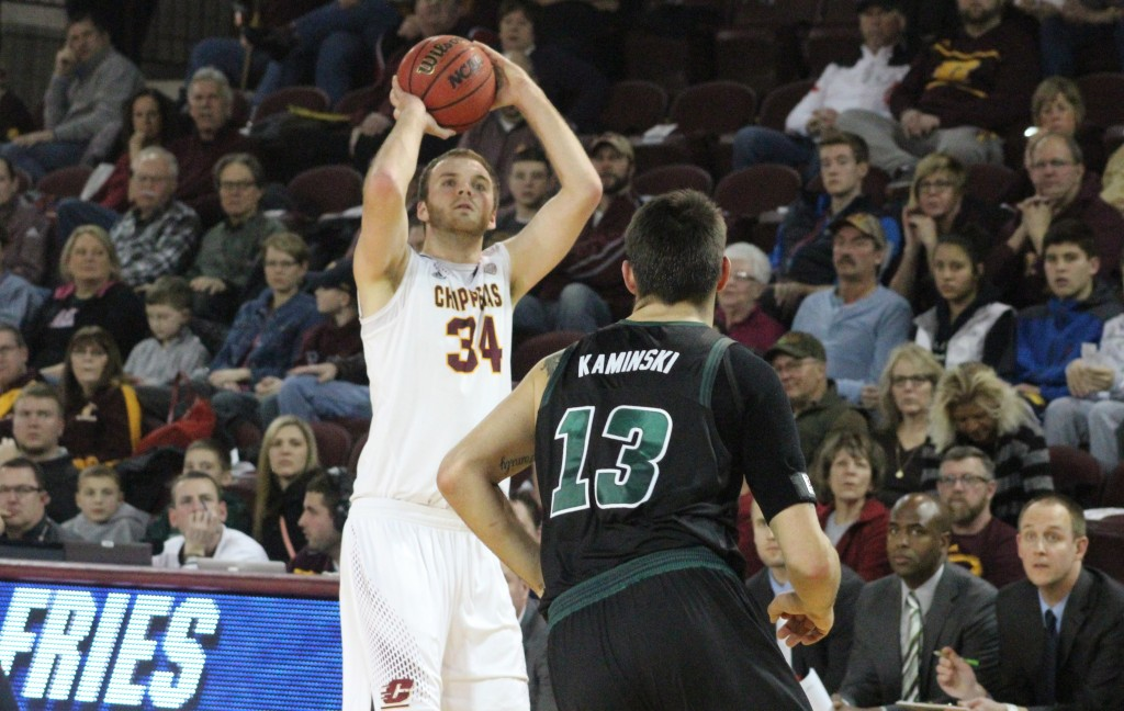 Forward John Simons (34) shoots a three-pointer in the second half Central Michigan's 72-49 victory against Ohio University.