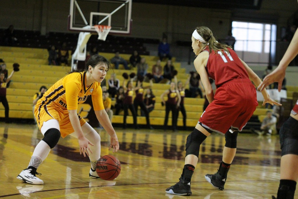 Guard Presley Hudson goes for the crossover in the fourth quarter against Miami University at McGuirck Arena on the campus of Central Michigan University on January 30, 2016.