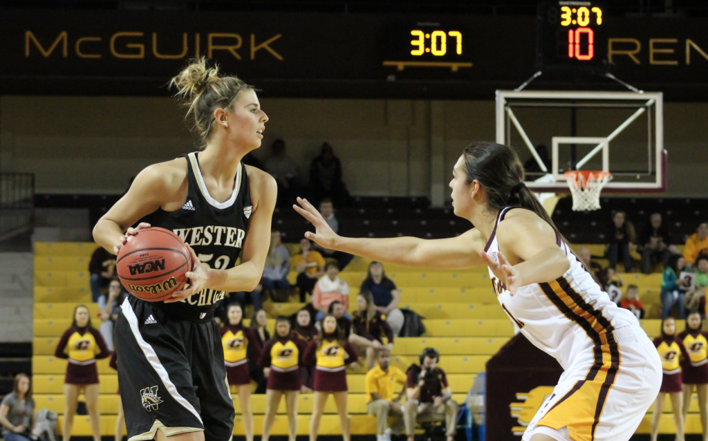 Forward Reyna Frost (13) defends the arch in the victory against Western Michigan University.