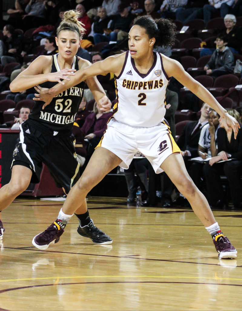Forward Tinara Moore (2) boxes out in the second quarter of the 53-51 victory against Western Michigan University.