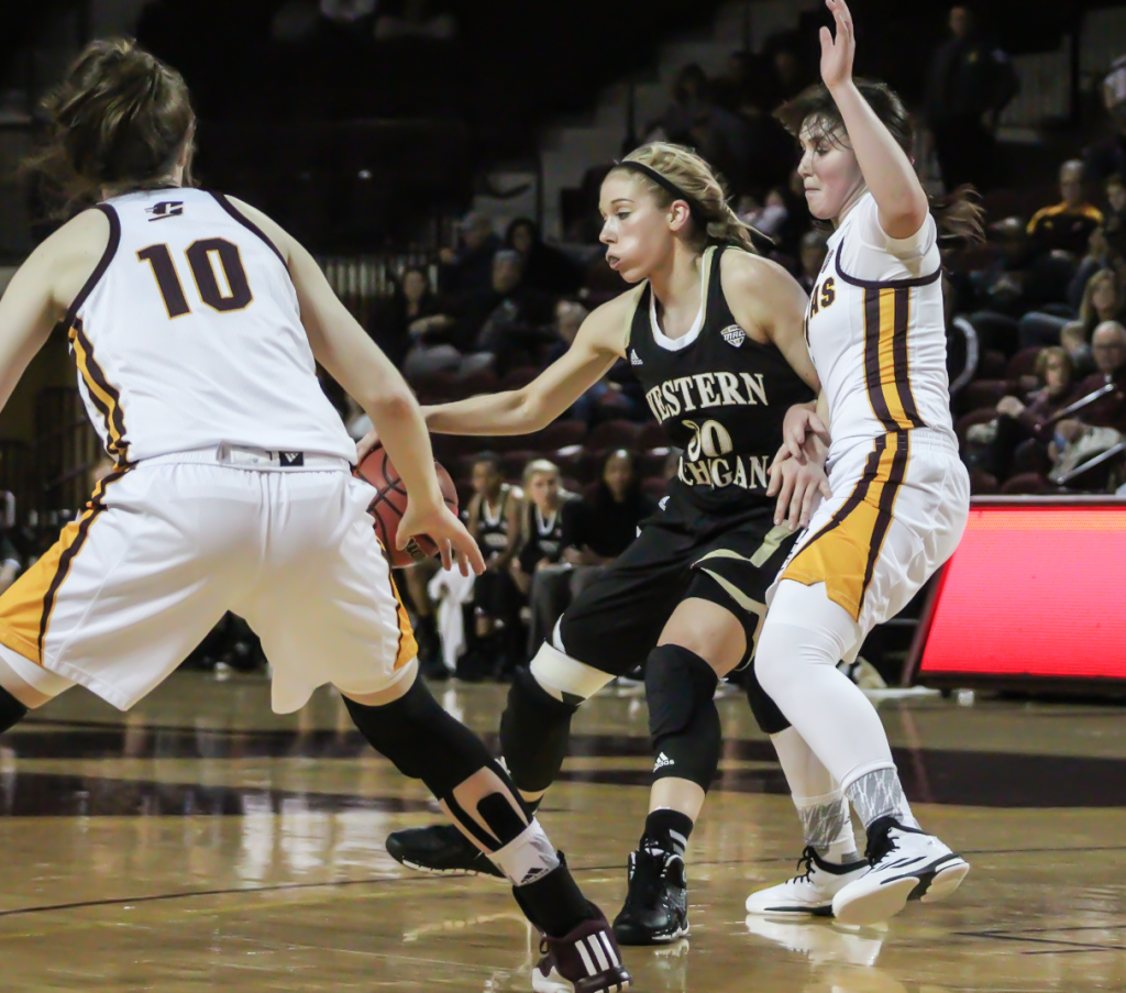 Guards Presley Hudson (3) and Cassandra Breen (10) defend the paint in the second quarter against Western Michigan University.