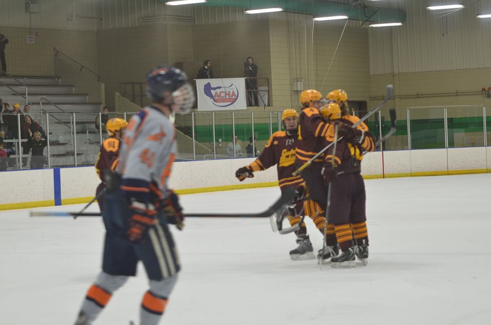 Nolan LeClaire gets hugged by teammates after scoring in the ACHA Regional Finals vs Hope (Photo: Laura Bragg)