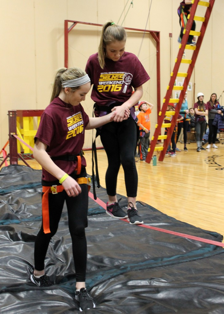 Macy (13) and Parker (10) pose for a portrait at Sibling's Weekend activities on the Campus of Central Michigan University on Sunday January 31, 2016.