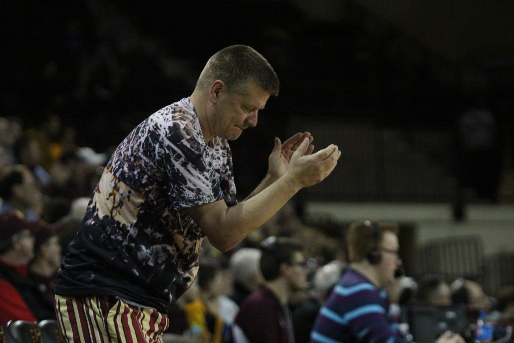 CMU professor Tim Otteman claps as CMU draws a offensive foul at McGurick Arena on the campus of Central Michigan University on February 3, 2016.
