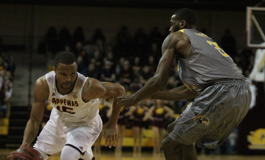 Guard Chris Fowler (15) drives the lane in the 88-61 win against Kent State at McGurick Arena on the campus of Central Michigan University on February 3, 2016.