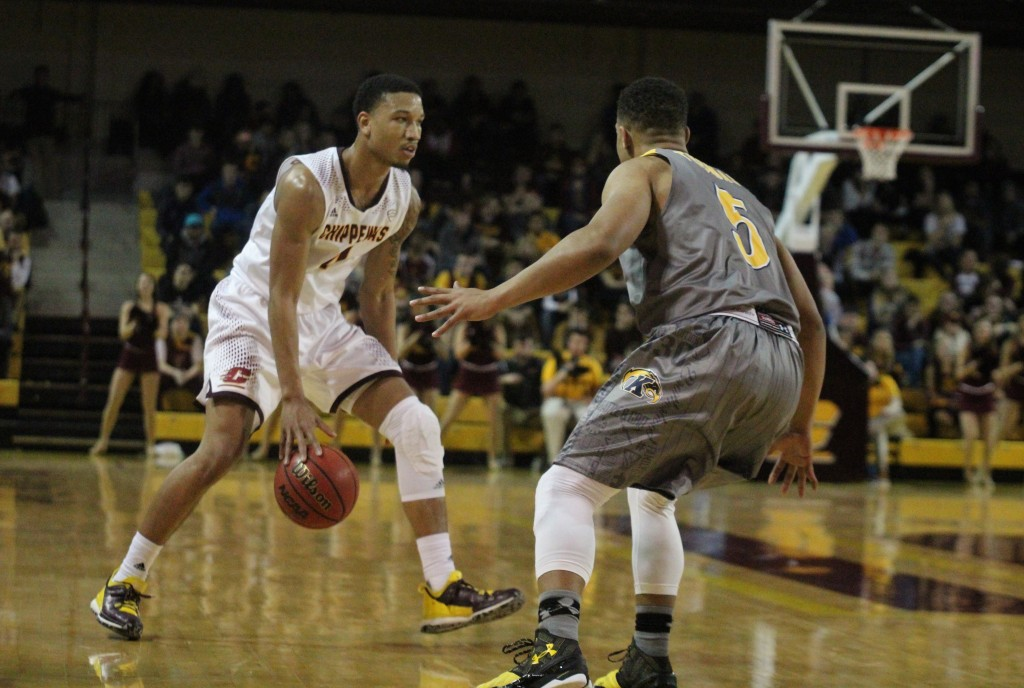 Guard Rayshawn Simmons (4) goes for the crossover in the first half against Kent State at McGurick Arena on the campus of Central Michigan University on February 3, 2016.