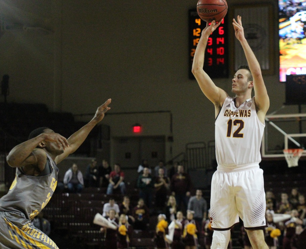 Guard Josh Kozinski (12) shoots a three pointer in the second half against Kent State at McGurick Arena on the campus of Central Michigan University on February 3, 2016.