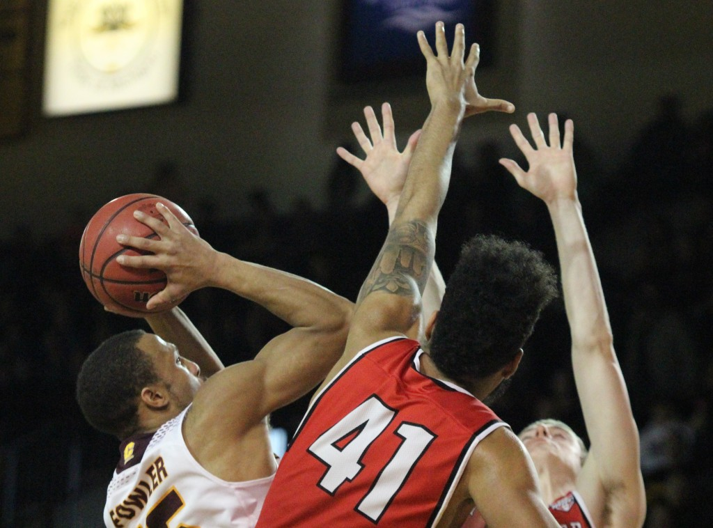 Guard Chris Fowler (15) goes up for a lay-up in the 75-66 loss to Ball State at McGuirck Arena on Saturday, Feb. 10.